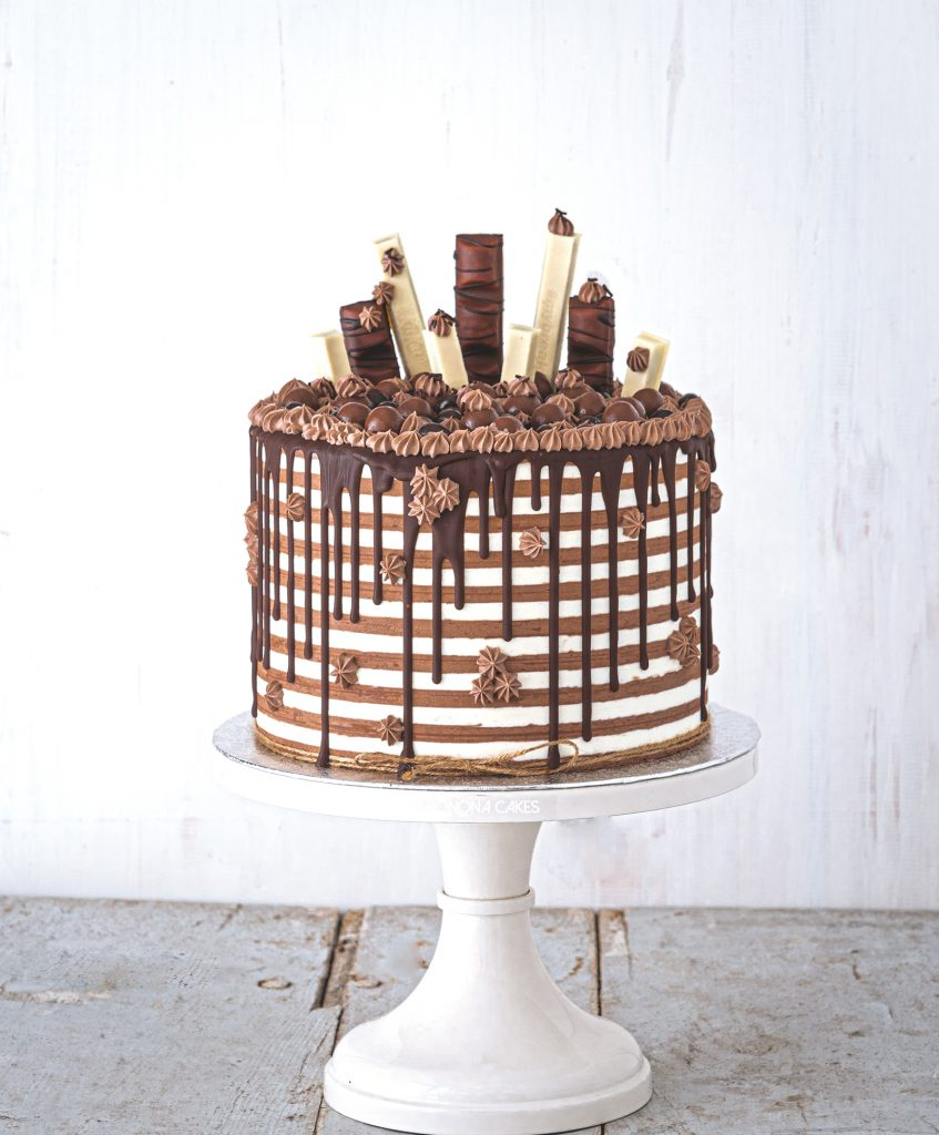 striped chocolate and vanilla drip cake