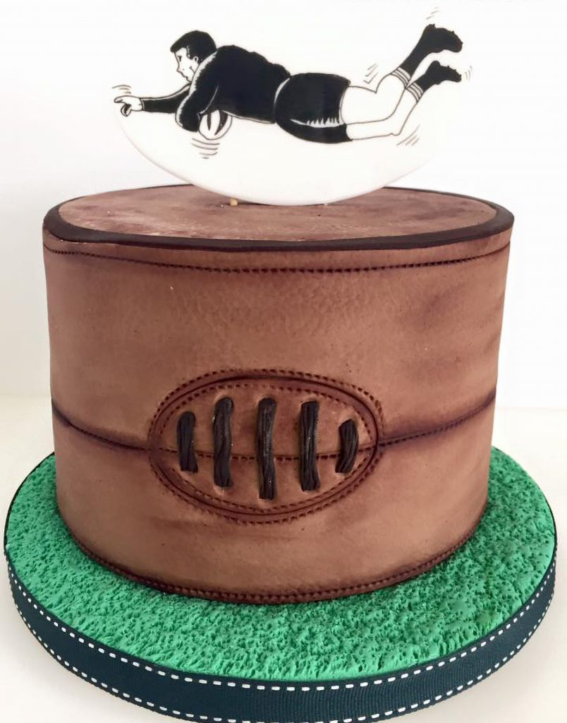 rugby ball player cake ponona cakes